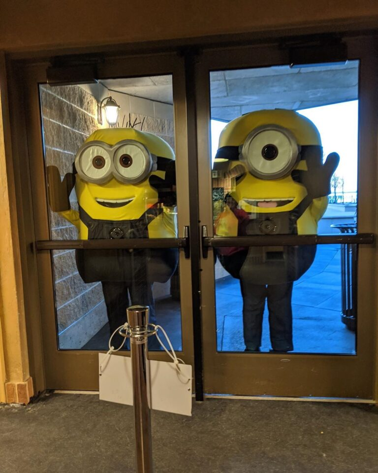 Minions standing outside of a door